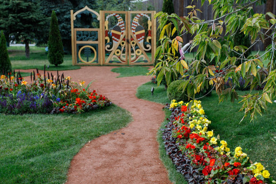 Landscape in the summer. Landscaping with flower beds