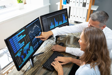 Stock Market Broker Analyzing Graphs On Laptop Wall mural