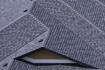 Rooftop in a newly constructed subdivision in Kelowna British Columbia Canada showing asphalt shingles