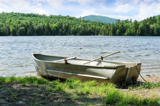 A rowboat docked on the side of a lake in Western Maine