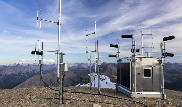 Meteorological Weather Station Building Exterior with Solar Panels and Measurement Instruments on Bourgeau Mountain Peak, Canadian Rockies, Banff National Park