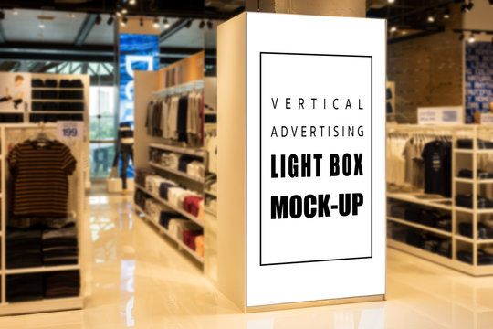 Mock up perspective vertical light box in clothing showroom
