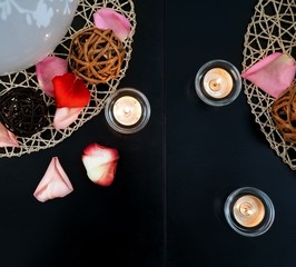 Table decoration with candles and wicker balls