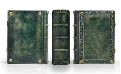 Green leather cover with embossed frame and metal pins in the corners