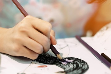 Girl using colored pencils to paint images