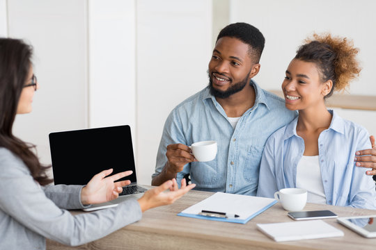 Afro Couple Attending Home Buying Consultation In Real Estate Agency