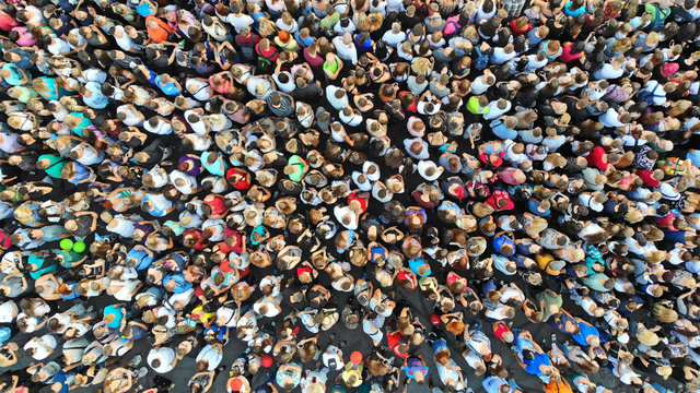 Aerial. People crowd background. Mass gathering of many people in one place. Top view.