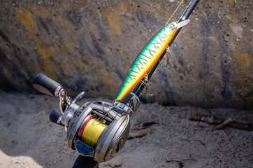 A photo of a rigged up baitcasting reel ready to catch a giant pike. Close-up