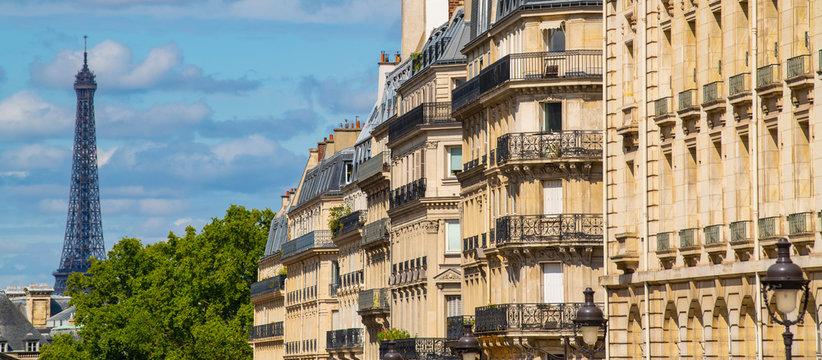 Eiffel tower between Parisian tenement old street alley and buildings