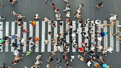 Aerial. People crowd on pedestrian crosswalk. Top view background.