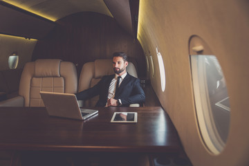 Businessman flying on his private jet Wall mural
