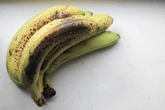 Old bananas on a white background