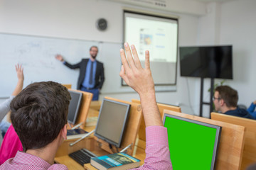 Male professor explain lesson to students and interact with them in the classroom.Helping a...