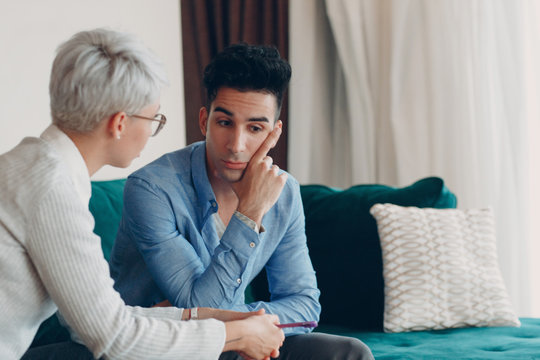 Consultation of young male patient on reception for psychologist. Family problems