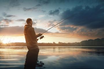 Foto auf AluDibond Fischerei Angler im Wasser