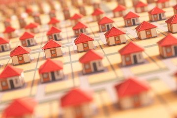 Homemade toy houses with red paper roofs. Selective focus, blurred background for design of construction news and mortgages. Close-up, macro. Abstract model of a village or city district.