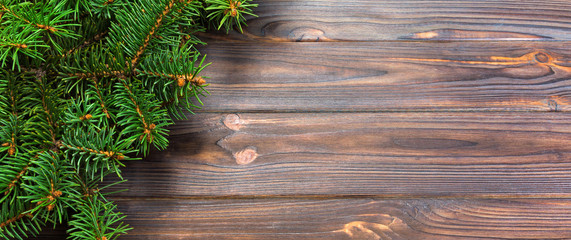 Wall Mural - Christmas gray wooden background with fir tree and copy space. top view banner empty space for your design