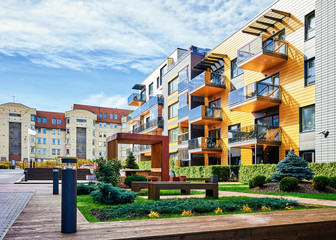 Modern complex of residential buildings with many benches Fototapete
