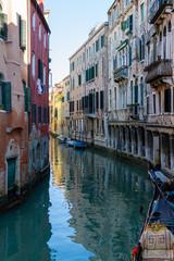 Foto op Canvas Gondolas Venezia (Venice), Italy. 2 February 2018. Gondolas and boats on the rivers of Venice.