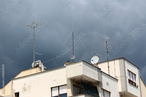 Apartment building with multiple radio and TV antennas on ...
