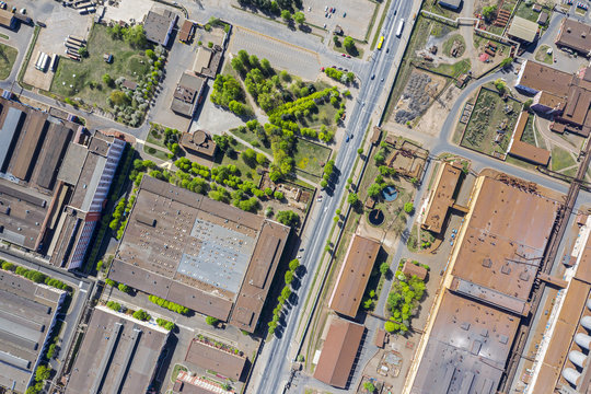 aerial top view of roofs of industrial buildings. suburb industrial zone. drone image
