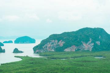 Foto op Aluminium Groene koraal Unidentified people sightseeing at Samet Nang She point looking through Phang Nga Bay in Phang Nga, Thailand