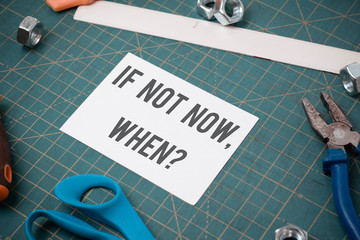 Writing note showing If Not Now When Question. Business concept for start acting from this moment do not hesitate Stationary and carpentry tools with paper above a textured backdrop