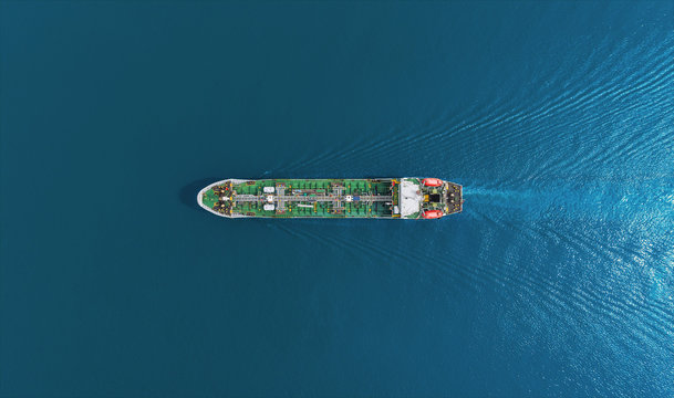 Aerial top view Oil ship tanker delivery oil from refinery on the sea.