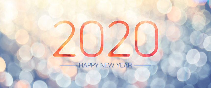 Happy new year 2020 banner with pale yellow and blue bokeh light sparkling background,Holiday greeting card