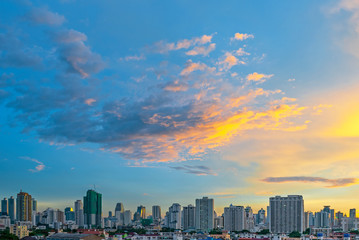 Fotomurales - The modern skyscrapers and urban skyline of Bangkok during a colorful sunrise, Thailand.