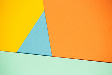 Photo of colored sheets of paper: yellow, orange, blue, green. Suitable for design templates, covers, banners, reports, abstractions, wallpapers