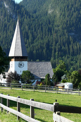 The ancient church in Saanen, Switzerland, in the morning (summer 2019)