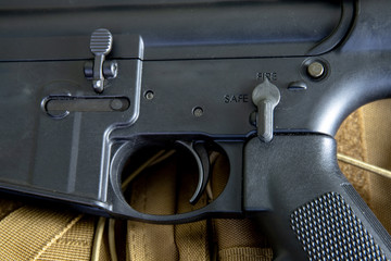 close up of m4 carbine, black rifle, assault rifle. Details of commands of safe and hold open