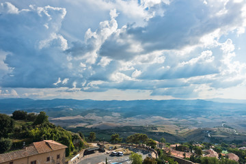 Cityscape over the roofs and surrounding landscape, a view from bell tower at Piazza dei Priori in Volterra, Tuscany, Italy