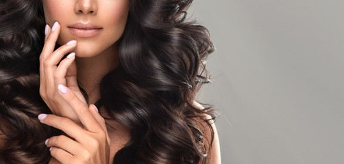 Beauty brunette girl with long  and   shiny wavy black hair .  Beautiful   woman model with curly...
