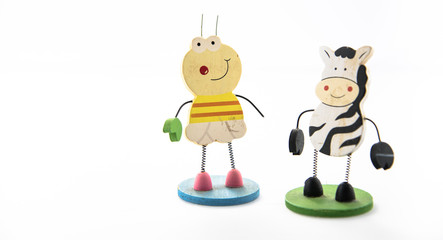 Cow and bee figures isolated on white background