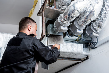 Ventilation cleaning. Specialist at work. Repair ventilation system (HVAC)