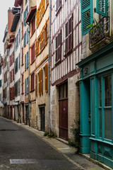 Picturesque street in Bayonne old town with tradition half timbered houses, France