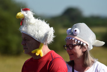 Competitors wear fancy hats in the World Bog Snorkelling Championships, Llanwrtyd Wells, Powys, Wales