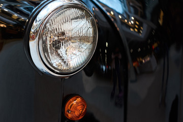 Fond de hotte en verre imprimé Vintage voitures Close up headlight of a black vintage car