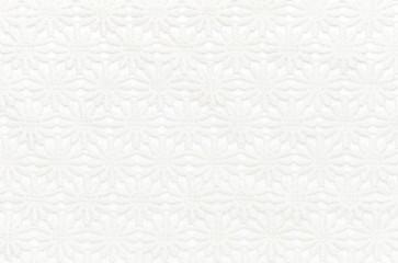 Beautiful white lace on white background. Background image, texture.