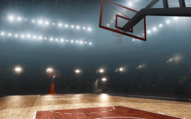 Basketball court with hoop. Floodlit sports arena.