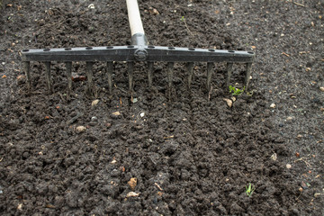 Loosening the excavated ground with a rake close-up