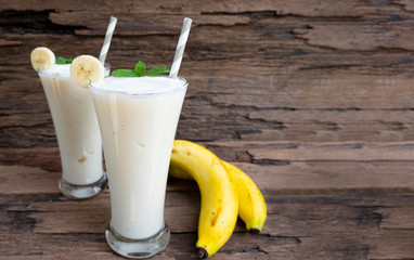 Banana fresh cocktail vanilla smoothies fruit juice beverage healthy the taste yummy in glass drink episode good morning on wooden background.