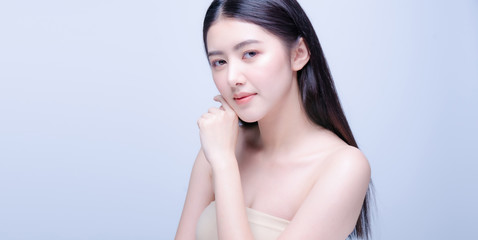 Beautiful Young asian Woman with Clean Fresh Skin look at camera. Girl beauty face care. Facial treatment. Cosmetology, beauty and spa