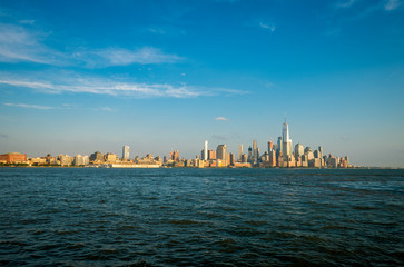 Golden sunset view of the Downtown Manhattan New York City skyline from across the Hudson River in New Jersey