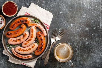 Grilled sausages with beer, ketchup and salt