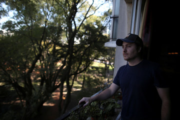 Guillermo Galia poses for a picture at his home, in Buenos Aires