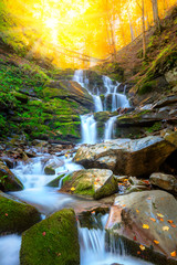 Poster de jardin Cascades Autumn mountain waterfall stream in the rocks with colorful fallen dry leaves, landscape