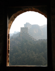 Fotobehang Chinese Muur The Great Wall of China. This section of the Great Wall is Jinshanling, a wild part with scenic views. The Great Wall of China near Beijing. Wild Great Wall of China, Jinshanling, Beijing, window view